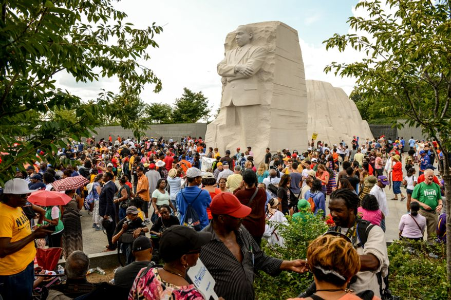 "People gather at the Martin Luther King Jr. Memorial in Washington on Saturday, Aug. 24, 2013, during a march to commemorate the 50th anniversary of the March on Washington and King's famous ""I Have a Dream"" speech. (Andrew Harnik/The Washington Times)"