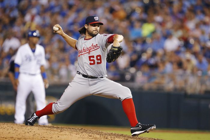 Washington Nationals relief pitcher Tanner Roark (59) during a baseball game against the Kansas City Royals at Kauffman Stadium in Kansas City, Mo., Friday, Aug. 23, 2013. (AP Photo/Orlin Wagner)