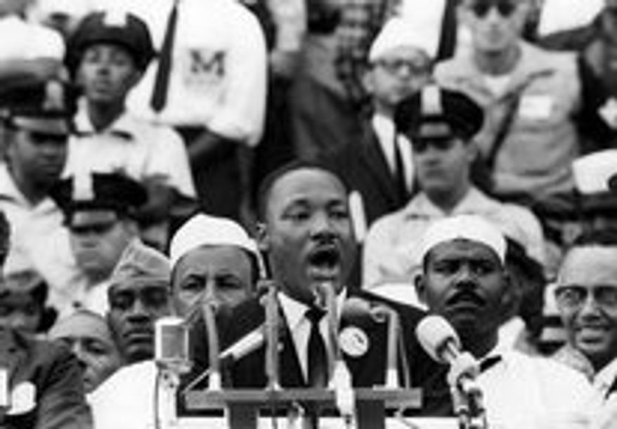 """D.C. police Officer Ken Collins stands behind the left shoulder of Martin Luther King Jr. as King delivers his """"I Have a Dream"""" speech Aug. 28, 1963. (associated press)"""