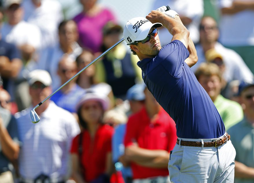Adam Scott, of Australia, tees off on the fifth hole during the final round of The Barclays golf tournament Sunday, Aug. 25, 2013, in Jersey City, N.J. (AP Photo/Rich Schultz)