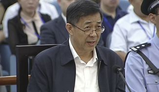 Chinese politician Bo Xilai speaks during his trial in Jinan Intermediate People's Court in Jinan, in eastern China's Shandong province, on Sunday, Aug. 25, 2013. Mr. Bo sought to discredit his former top aide as a lying, unreliable witness as the ousted leader denied criminal responsibility in the country's messiest political scandal in decades. (AP Photo/CCTV via AP Video)