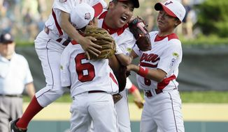 Tokyo, Japan players celebrate after winning the Little League World Series Championship baseball game against Chula Vista, Calif., Sunday, Aug. 25, 2013, in South Williamsport, Pa. Tokyo, Japan won 6-4. (AP Photo/Matt Slocum)