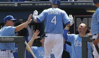 Kansas City Royals' Alex Gordon (4) is congratulated by manager Ned Yost, left, and Billy Butler, right, after hitting a home run off Washington Nationals pitcher Dan Haren in the first inning of a baseball game at Kauffman Stadium in Kansas City, Mo., Sunday, Aug. 25, 2013. (AP Photo/Colin E. Braley)