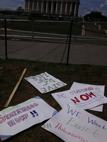 Signs from a D.C. statehood rally litter the National Mall in front of the Lincoln Memorial on Sunday, Aug. 25, 2013, a day after the