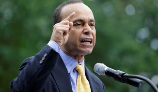 Border Buster: Rep. Luis V. Gutierrez, Illinois Democrat, took his immigration reform message to the districts of two Virginia Republicans: Rep. Frank R. Wolf and Rep. Bob Goodlatte. (Associated Press)