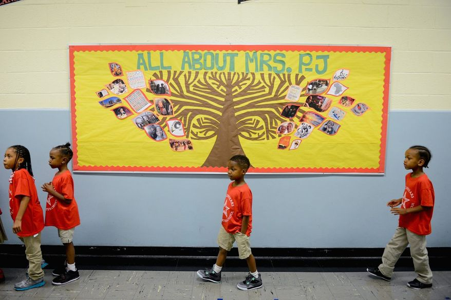 First-graders make their way to class as they return to school after a summer away from lessons and homework. (Photographs by Andrew Harnik/The Washington Times)