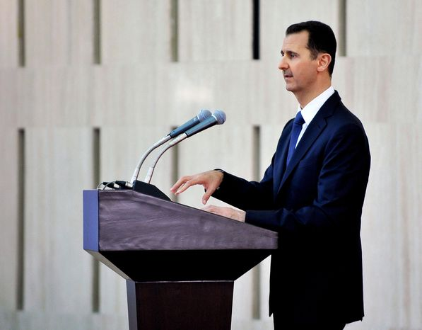 ** FILE ** In this Sunday, Aug. 4, 2013, file photo released by the Syrian official news agency SANA, Syrian President Bashar Assad delivers a speech at an Iftar dinner with political and religious figures in Damascus, Syria. (AP Photo/SANA, File)