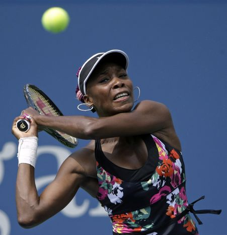 Venus Williams returns a shot to Belgium's Kirsten Flipkens during the first round of the 2013 U.S. Open tennis tournament, Monday, Aug. 26, 2013, in New York. Williams defeated Flipkens. (AP Photo/