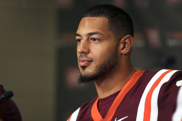 Virginia Tech quarterback Logan Thomas attends NCAA college football media day in Lane Stadium on campus in Blacksburg, Va., Saturday, Aug.10 2013. (AP Photo/The Roanoke Times, Matt Gentry)