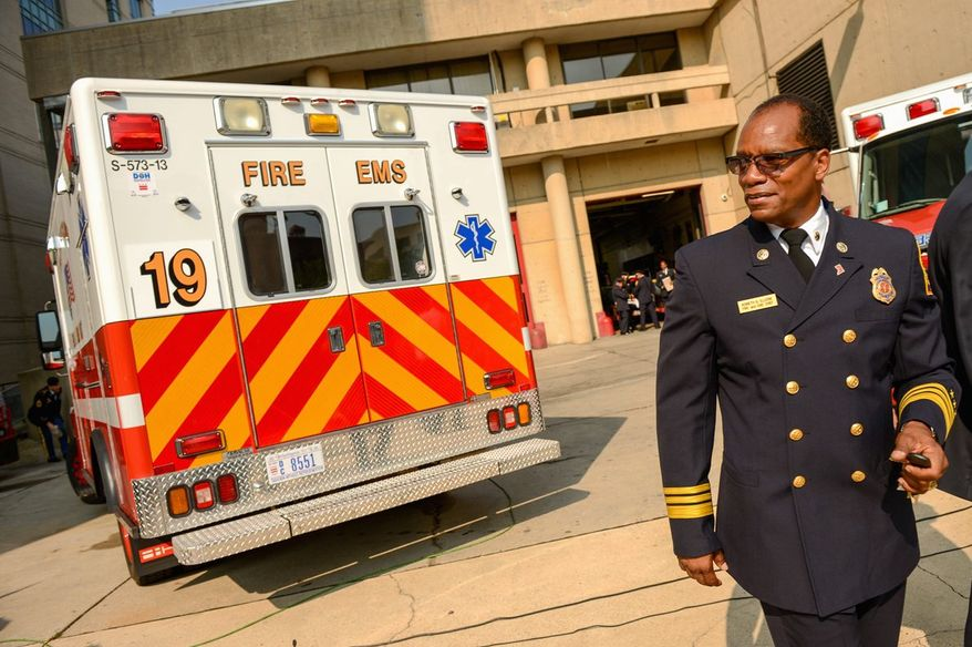 Fire Chief Kenneth B. Ellerbe says the D.C. fire department will buy new ambulances and hire single-role paramedics to bolster response capabilities. A news conference with Mayor Vincent C. Gray at the Chinatown fire station Tuesday got testy as the paramedic plan runs counter to recommendations made years ago. (Andrew Harnik/The Washington Times)