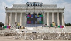 "Chairs, metal risers and video screens are set up at the Lincoln Memorial on Tuesday in preparation for the 50th anniversary of the March on Washington celebrations that will be held Wednesday. President Obama, who is scheduled to speak, was 2 years old and living in Hawaii when Martin Luther King Jr. delivered his ""I Have a Dream"" speech from the steps of the Lincoln Memorial. (Associated Press)"