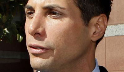 """**FILE** Joe Francis, the founder of the """"Girls Gone Wild"""" video empire, leaves the Edward R. Roybal Center and Federal Building court on in Los Angeles on Sept. 23, 2009. (Associated Press)"""