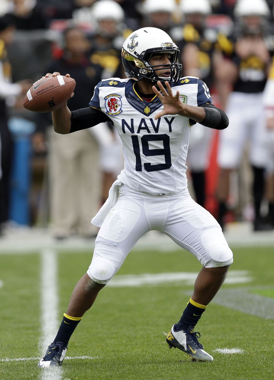 **FILE** Navy quarterback Keenan Reynolds (19) in action against Arizona State during the Fight Hunger Bowl NCAA college football game in San Francisco, Saturday, Dec. 29, 2012. (AP Photo/Marcio Jose Sanchez)