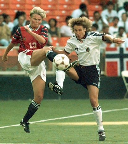 **FILE** Norway's Tina Svensson (13) battles Germany's Martina Voss (7) during first half action of their Olympic soccer game at RFK Stadium, Washington, Tuesday July 23, 1996. (AP Photo/Greg Gibson)