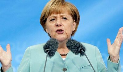 German Chancellor Angela Merkel speaks at an election campaign event of Germany's Christian Democratic Union (CDU) in Ilmenau, Germany, on Monday, Aug. 26, 2013. (AP Photo/Jens Meyer)