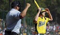 Chula Vista, Calif.'s Grant Holman reacts after striking out to Tokyo, Japan's Kazuki Ishida during the second inning of the Little League World Series Championship baseball game, Sunday, Aug. 25, 2013, in South Williamsport, Pa. Tokyo, Japan won 6-4. (AP Photo/Matt Slocum)