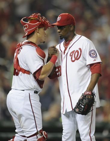 Rafael Soriano and Wilson Ramos celebrate the Nationals' 2-1 victory over the Miami Marlins. (Associated Press photo).