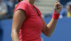 Petra Kvitova of the Czech Republic reacts during a first round match against Misaki Doi, of Japan, at the 2013 U.S. Open tennis tournament Tuesday, Aug. 27, 2013, in New York. (AP Photo/Mike Groll)