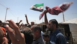 Although Syrian refugees are calling for the ouster of President Bashar Assad, a growing number of jihadist organizations are fighting to take his place. (Associated Press)