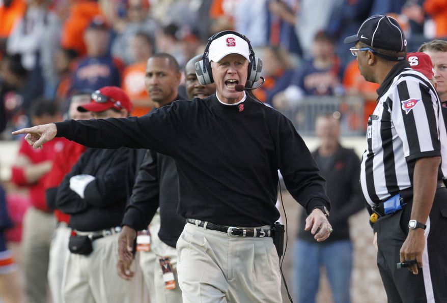North Carolina State head coach Tom O'Brien yells at an official during the second half of an NCAA College football game against North Carolina State at Scott Stadium in Charlottesville, Va., Saturday, Oct. 22, 2011. NC State won 28-14. (AP Photo/Steve Helber)