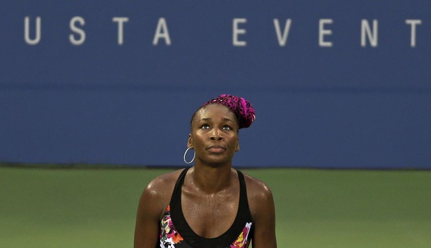 Venus Williams reacts during a second round match against Jie Zheng, of China, during the 2013 U.S. Open tennis tournament, Wednesday, Aug. 28, 2013, in New York. (AP Photo/Darron Cummings)