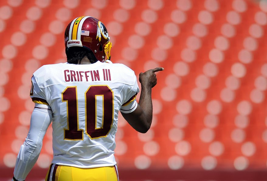 Washington Redskins quarterback Robert Griffin III warms up before an NFL preseason football game against the Buffalo Bills Saturday, Aug. 24, 2013, in Landover, Md. (AP Photo/Nick Wass)