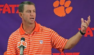 Clemson head NCAA college football coach Dabo Swinney discusses the Tigers' season opening game against Georgia at a news conference in Clemson, S.C., Tuesday, Aug. 27, 2013. (AP Photo/Anderson Independent-Mail, Mark Crammer)
