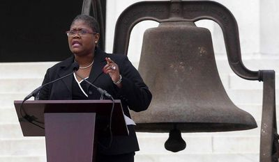 "Melanie Campbell, president and CEO of the National Coalition on Black Civic Participation, speaks at the Lincoln Memorial in Washington on Wednesday, Aug. 28, 2013, the 50th anniversary of the March on Washington, at which the Rev. Martin Luther King Jr. delivered his ""I Have a Dream"" speech. The bell behind her rang at the 16th Street Baptist Church in Birmingham, Ala., the bombing of which 18 days after the 1963 march killed four young girls. (AP Photo/Charles Dharapak)"