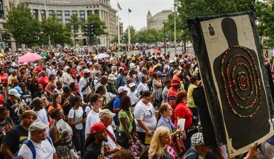 """People participate in a march down Pennsylvania Avenue to commemorate the 50th anniversary of the March on Washington and Martin Luther King Jr.'s famous """"I Have a Dream"""" speech in D.C. on Aug. 28, 2013. (Andrew Harnik/The Washington Times)"""