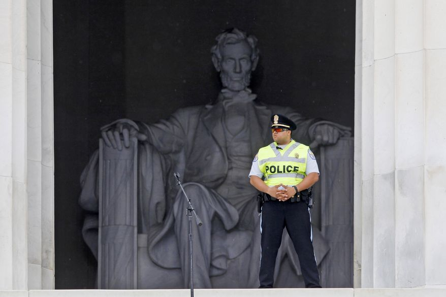 A U.S. Park Police officer stands watch before the start of the 50th Anniversary of the March on Washington where Martin Luther King, Jr., spoke in front of the Lincoln Memorial in Washington, Wednesday, Aug. 28, 2013. (AP Photo/Charles Dharapak)