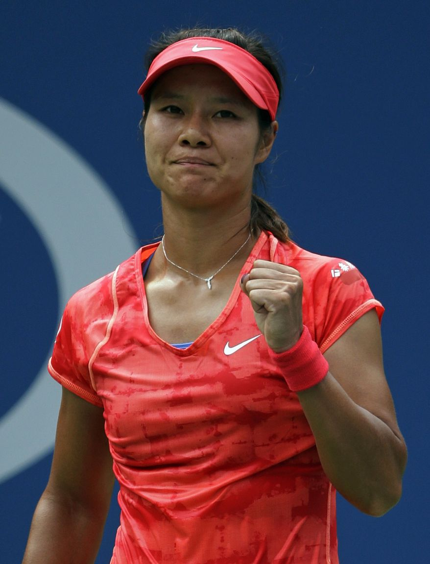Li Na, of China, reacts after defeating Sofia Arvidsson, of Sweden, during the second round of the 2013 U.S. Open tennis tournament, Wednesday, Aug. 28, 2013, in New York. (AP Photo/Kathy Willens)