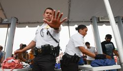 The Secret Service eventually added entry points to the Mall for the 50th anniversary of the March on Washington to deal with the long lines at the checkpoints, but by then many had missed some of the festivities. (Andrew Harnik/The Washington Times)