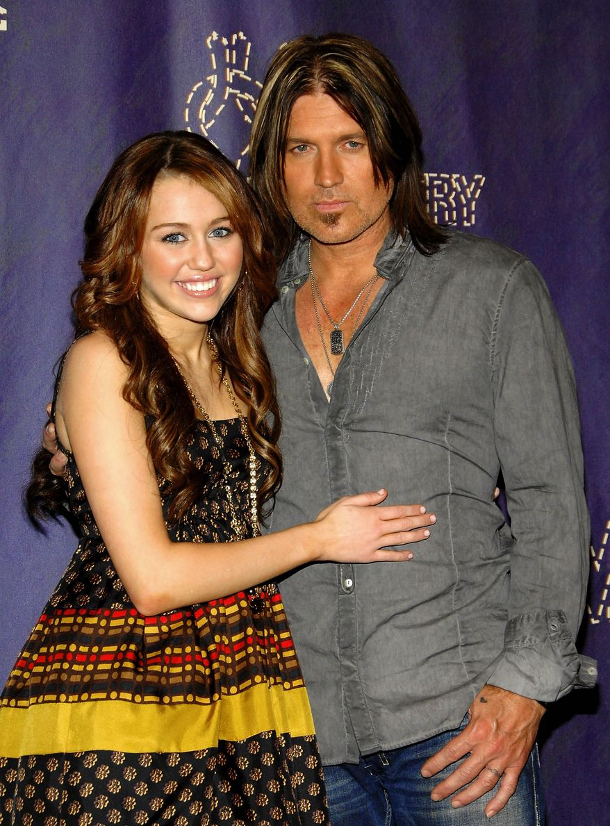 ** FILE ** In this April 14, 2008 file photo, Miley Cyrus and her father Billy Ray Cyrus pose in the press room at the 2008 CMT Awards in Nashville, Tenn. (AP Photo/Evan Agostini, file)