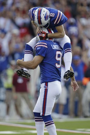 The author isn't quite as excited to have Rian Lindell (9) on his team as Brian Moorman (8) was after the kicker's game-winning field goal against the Patriots in 2011. (AP Photo/David Duprey)