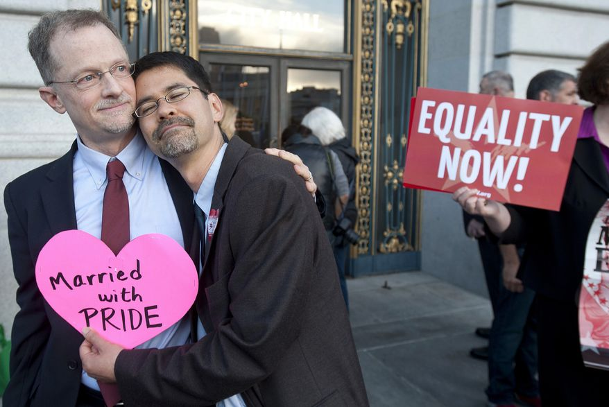 **FILE** John Lewis (left) and Stuart Gaffney embrace outside San Francisco's City Hall shortly before the U.S. Supreme Court ruling cleared the way for same-sex marriage in California on June 26, 2013. The justices issued two 5-4 rulings in their final session of the term. One decision wiped away part of a federal anti-gay marriage law that has kept legally married same-sex couples from receiving tax, health and pension benefits. The other was a technical legal ruling that said nothing at all about same-sex marriage, but left in place a trial court's declaration that California's Proposition 8 is unconstitutional. (Associated Press)