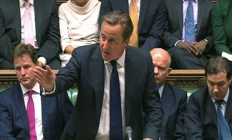 In this image taken from video, Britain's Prime Minister David Cameron, centre, speaks during a debate on Syria, in Britain's parliament, London, Thursday August 29, 2013. Britain's leaders said Thursday it would be legal under humanitarian doctrine to launch a military strike against Syria even without authorization from the United Nations Security Council, but it is not certain how much support there is for the government's resolution on Syria.  Behind Cameron are British Foreign Secretary William Hague, obscured 2nd right, and Deputy Prime Minister Nick Clegg, left. (AP Photo / PA) UNITED KINGDOM OUT - NO SALES - NO ARCHIVES