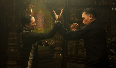 "Ziyi Zhang, left, and Tony Leung Chiu Wai in director Wong Kar Wai's ""The Grandmaster,"" which opens Friday. (AP Photo/Courtesy The Weinstein Company)"
