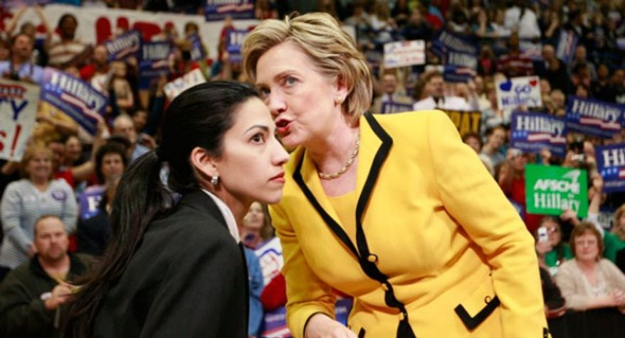 Hillary Rodham Clinton (right) shares a word with Huma Abedin, her personal assistant and trusted confidant. **FILE**