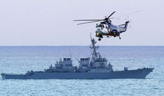 ** FILE ** A Lebanese army helicopter flies past the USS Ramage as search efforts continued for a downed airliner near Beirut in 2010. The USS Ramage is one of four U.S. Navy destroyers in the eastern Mediterranean Sea waiting for a possible order to launch against Syria. The United States and its allies accuse Syrian President Bashar Assad of allegedly using deadly chemical weapons, possibly including sarin gas, to kill a thousand Syrians. (AP Photo/Ben Curtis)