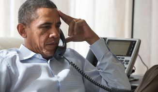 ** FILE ** President Obama speaks by phone with his National Security Staff regarding the situation in Egypt, while in Chilmark, Mass., Aug. 15, 2013. (Official White House Photo by Amanda Lucidon)