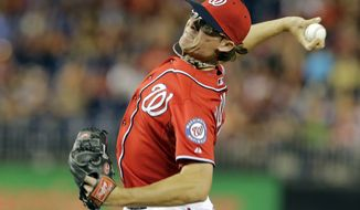 Washington Nationals relief pitcher Tyler Clippard (36) throws during a baseball game against the Philadelphia Phillies at Nationals Park Saturday, Aug. 10, 2013, in Washington. The Nationals won 8-5. (AP Photo/Alex Brandon)