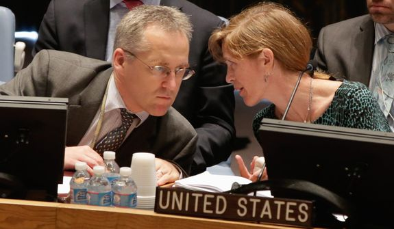 U.S. Ambassador Samantha Power talks with British delegate Michael Tatham in the United Nations Security Council,  Thursday, Aug. 29, 2013. U.N. Secretary-General Ban Ki-moon said the Inspection team in Syria is expected to complete its work Friday and report to him Saturday. (AP Photo/Richard Drew)