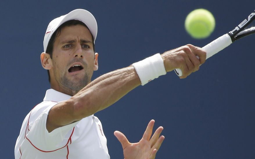 Novak Djokovic of Serbia returns a shot from Benjamin Becker of Germany during the second round of the 2013 U.S. Open tennis tournament, Friday, Aug. 30, 2013, in New York. (AP Photo/David Goldman)