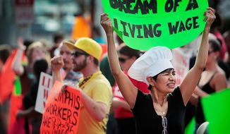 Christina Condori joins a crowd of low-income fast food workers and their supporters in protest on Thursday, Aug. 29, 2013, while picketing outside of the McDonald's restaurant in Memphis, Tenn. (AP Photo/The Commercial Appeal, Jim Weber)