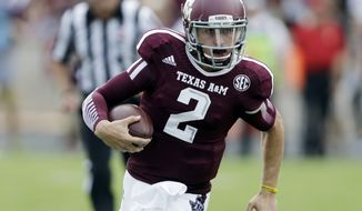 Texas A&M's Johnny Manziel (2) scrambles for yards during the third quarter of an NCAA college football game against Rice, Saturday, Aug. 31, 2013, in College Station, Texas. Manziel missed the first half due to an NCAA suspension. (AP Photo/Eric Gay)