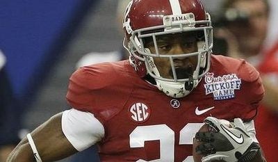 Alabama wide receiver Christion Jones (22) runs past Virginia Tech defensive end Matt Roth on a touchdown run on a punt return in the first half of an NCAA college football game, Saturday, Aug. 31, 2013, in Atlanta. (AP Photo/Dave Martin)