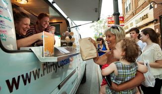 "Food trucks are a growing business, and a report from the NPD Group shows they are taking a bite out of the quick-service restaurants. But, ""For now at least, food trucks need not be viewed as a threat to restaurant demand nationally,"" an analyst at NPD says. (associated press)"