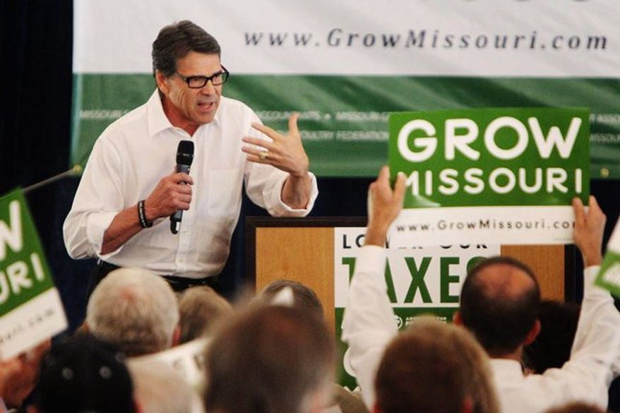 Texas Gov. Rick Perry speaks to business and Republican leaders in Chesterfield, Mo., in late August, warning them that unless there is an override of Gov. Jay Nixon's veto of an income-tax cut, he won't be the only governor trying to lure business away from Missouri. (St. Louis Post-Dispatch via Associated Press)