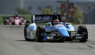 Simon Pagenaud, of France, drives during a warm up session for the IndyCar Grand Prix of Baltimore auto race, Sunday, Sept. 1, 2013, in Baltimore. (AP Photo/Nick Wass)