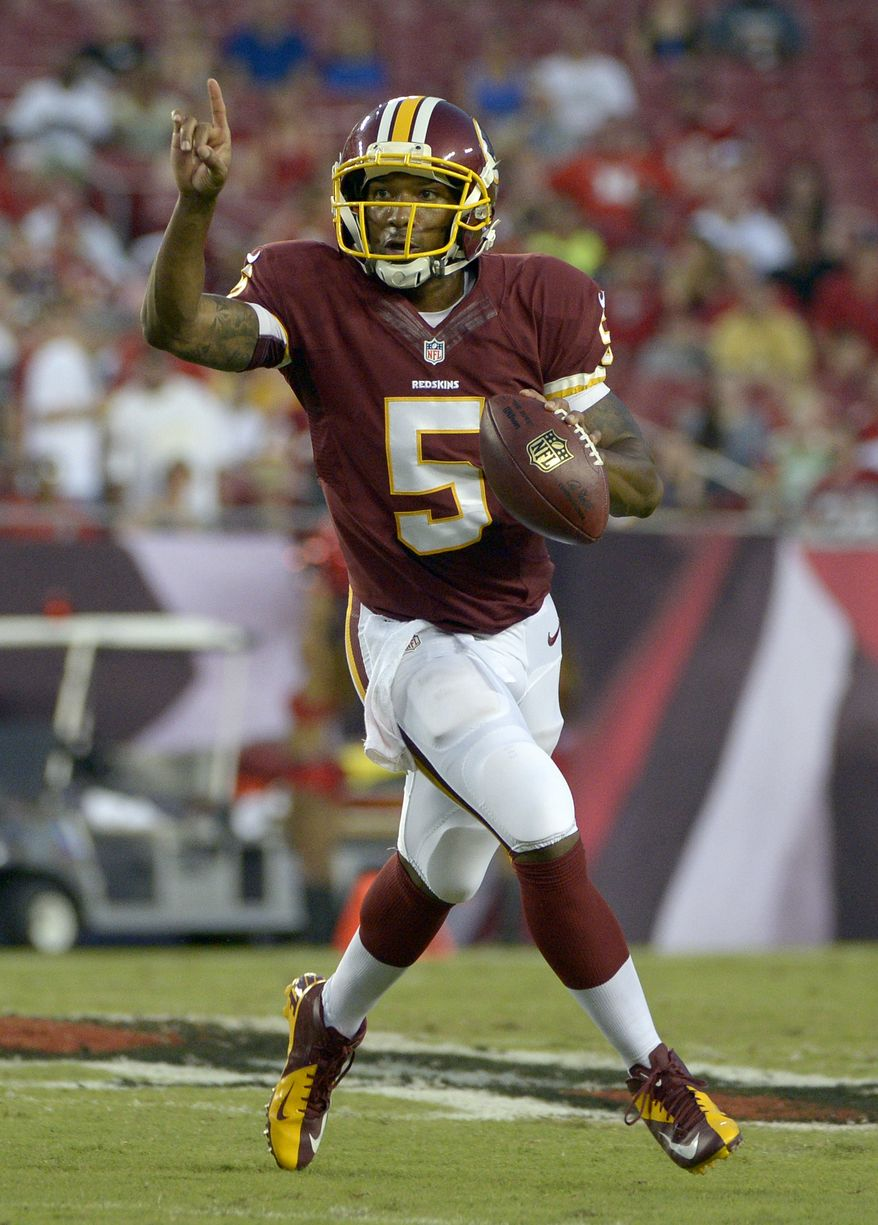 Washington Redskins quarterback Pat White (5) looks for an open receiver against the Tampa Bay Buccaneers during the first quarter of an NFL preseason football game Thursday, Aug. 29, 2013, in Tampa, Fla. (AP Photo/Phelan M. Ebenhack)